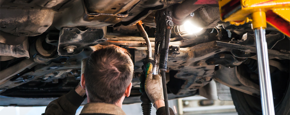 Mechanic underneath a vehicle Car Welding Colwick, Nottingham